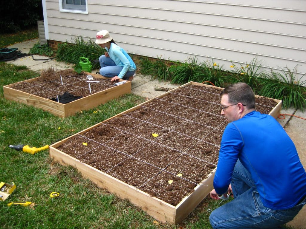 Want to make your own DIY Raised Garden Bed? This step-by-step tutorial will help get your garden up and growing in no time!