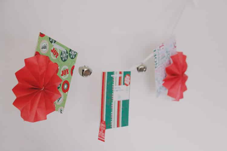 This easy to make Christmas Banner with paper flowers is the perfect way to spread a little holiday cheer throughout your home!