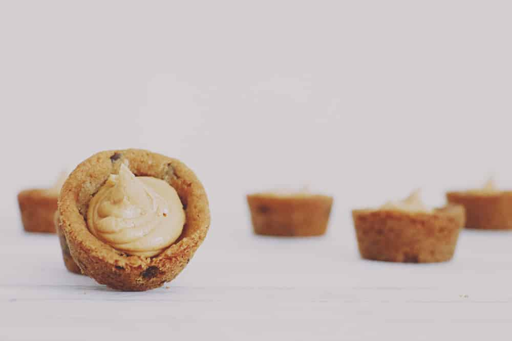 What could be better than peanut butter chocolate chip pies? Mini peanut butter chocolate chip pies! These little morsels are SUPER easy + delicious, too!