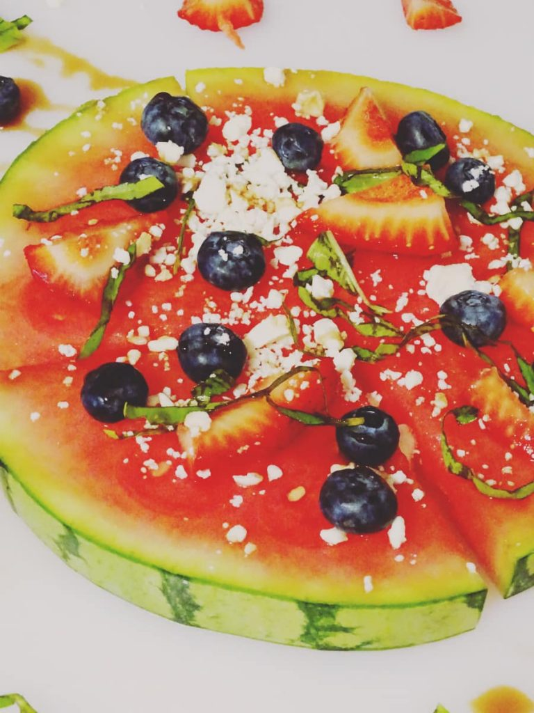 This refreshing watermelon fruit pizza is perfect for a lighter meal on a hot day. With watermelon as the base, you'll skip the extra calories, too!