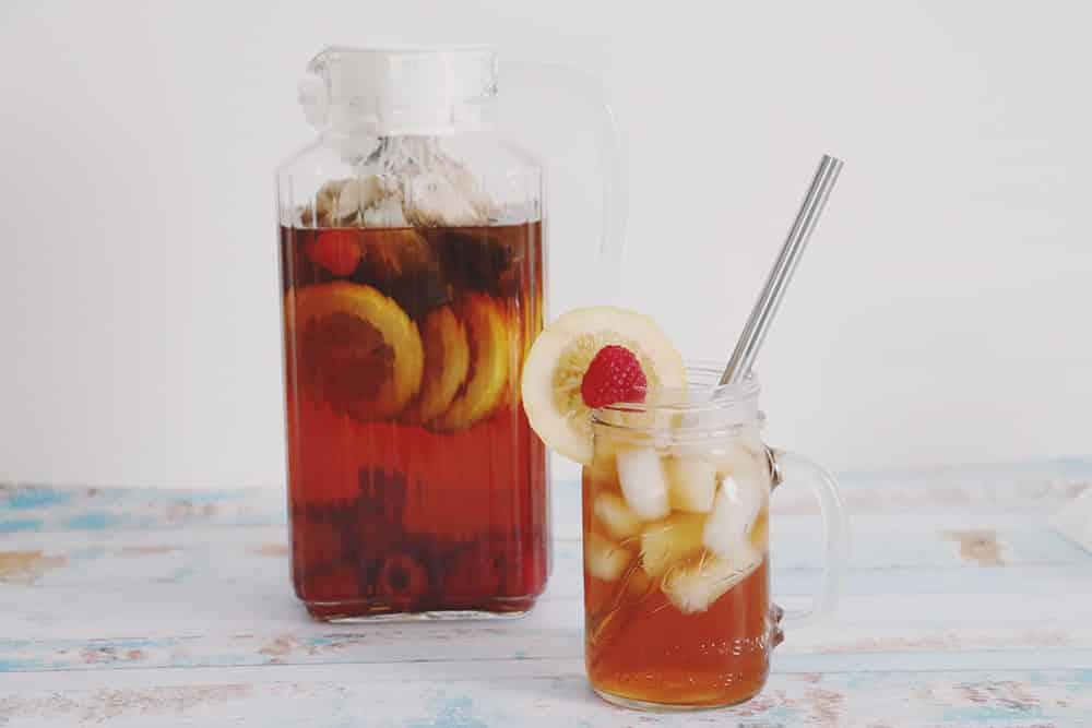 Cool off this Summer with this refreshing raspberry lemon sun tea recipe! It's a fun and fruity twist on your traditional sun tea!