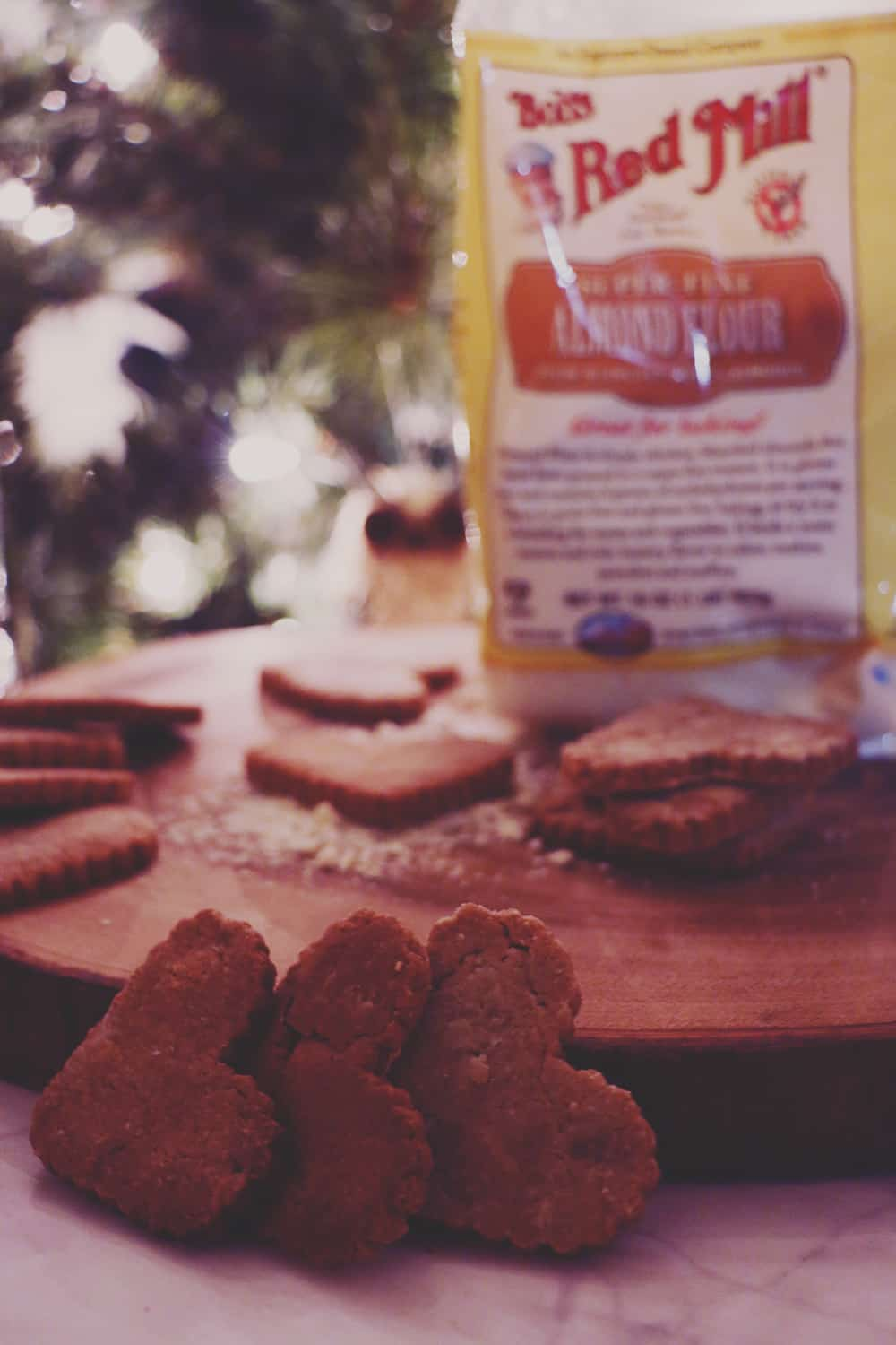 Need a gift for your furry friend? Make these deliciously easy Peanut Butter Almond Dog Biscuits! You'll never need store bought treats again!