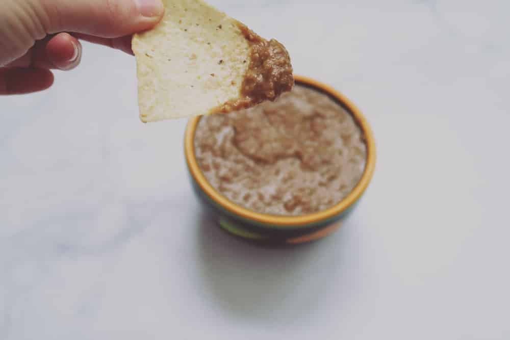 This simple slow cooker bean dip is perfect for game day snacking. Just a few ingredients and hours later you've got a deliciously easy dish!