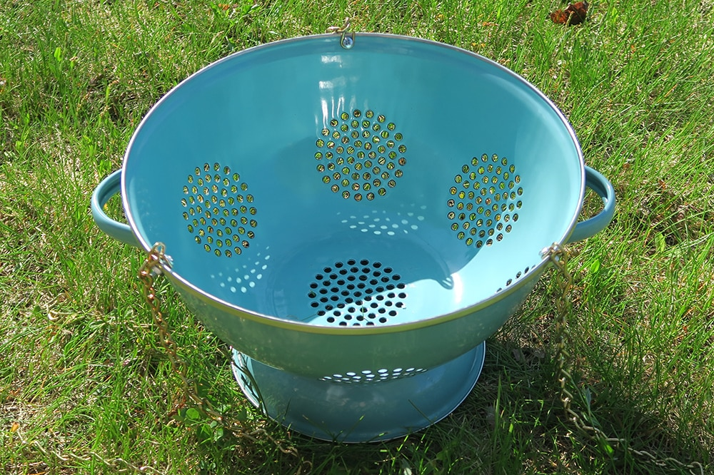 Container gardening just got more fun! With just a few supplies, you can turn a simple kitchen utensil into a unique DIY Hanging Colander Planter.