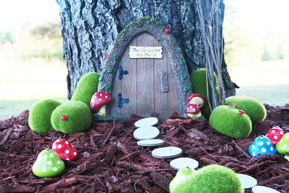 Want to add some whimsy to your yard? This simple DIY fairy garden is the answer! You'll turn your tree base into a magical scene in no time.