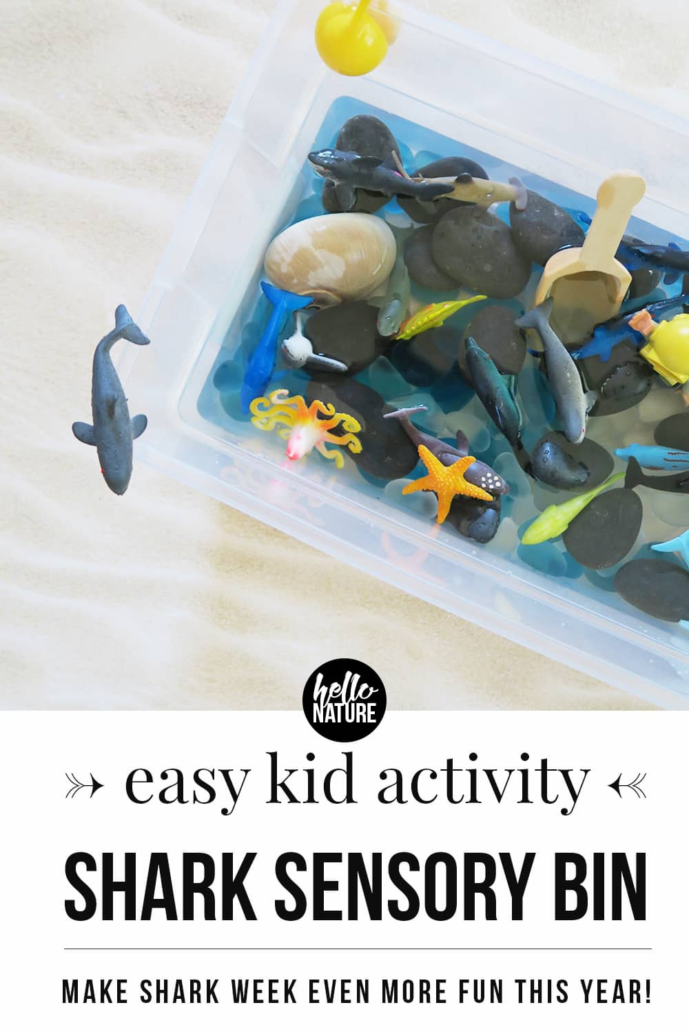 Need a fun indoor activity for your kids? Make this shark sensory bin! It's the perfect shark week activity for kids and it's a fintastic way to explore the ocean indoors! This is a toddler activity that can't be missed! #SensoryBin #ToddlerActivities #SharkWeek #IndoorActivities #IndoorToddlerActivities #RainyDayActivities