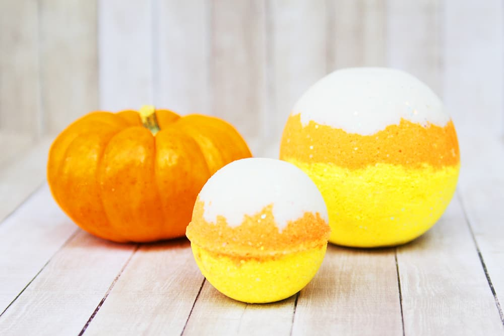 Need a fun Halloween craft for adults? Make these Candy Corn Bath Bombs! It's a super fun candy corn craft idea.