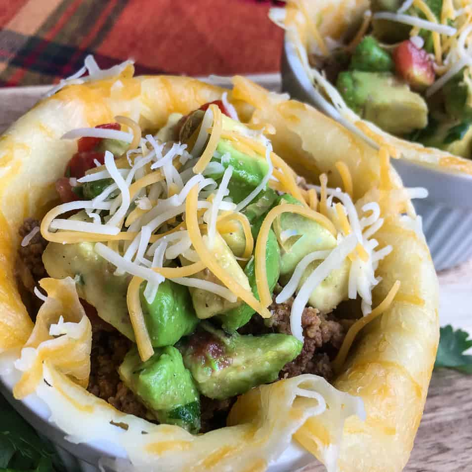 Looking for a low carb ground beef recipe? You won't want to miss this easy Keto friendly recipe! These Keto Taco Cups with Avocado Salsa will become a new weeknight favorite for the whole family.