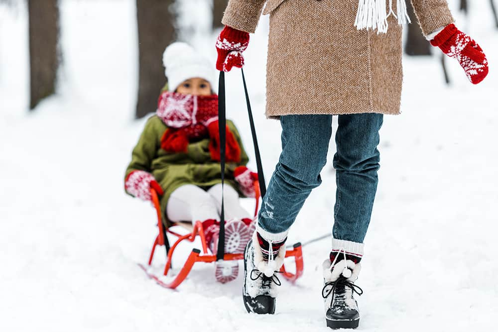 Get outside with your kids this winter! Try sledding, snow paint, snow ice cream and more.