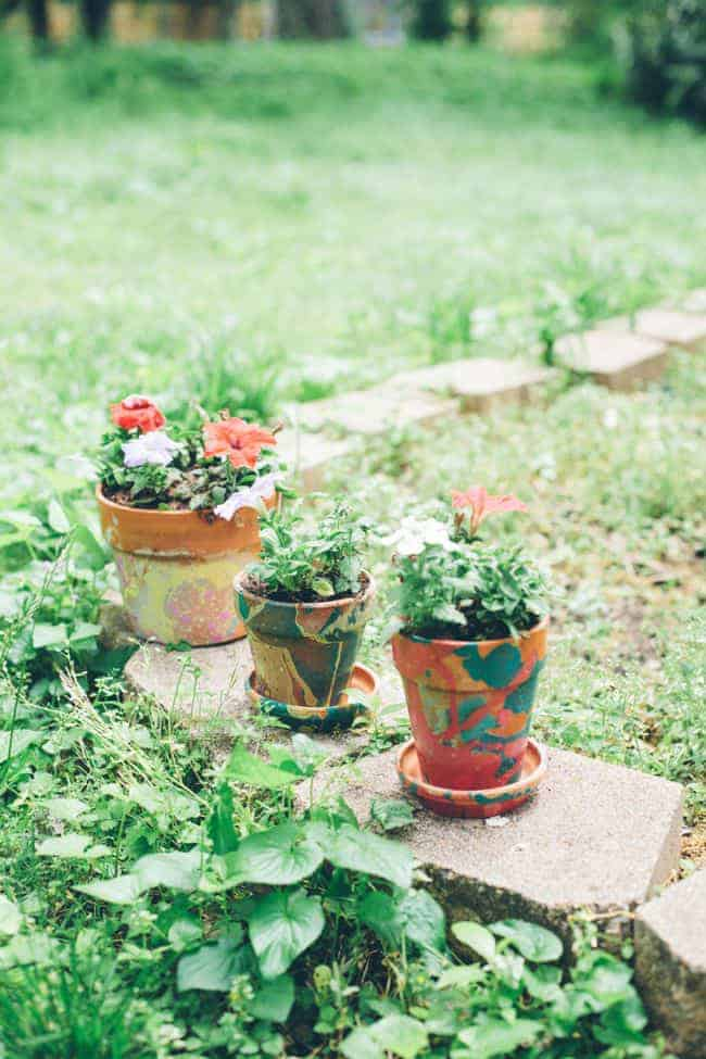 Nail polish painted terracotta pot planters.