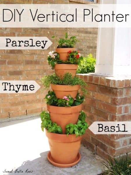 Stacked terracotta pots with fresh herbs.