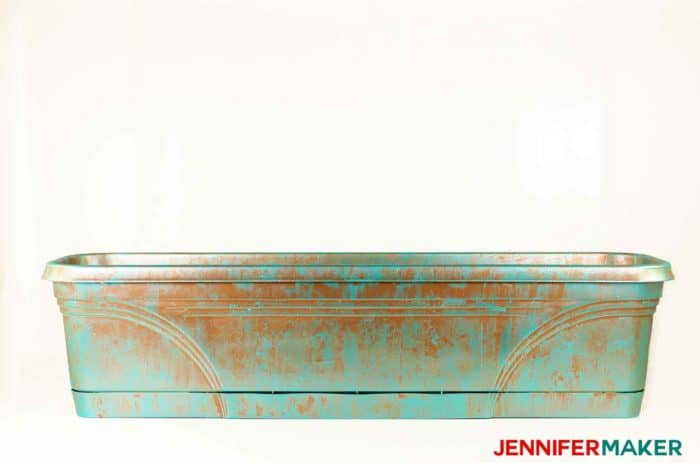 Plastic trough planter painted in copper patina.