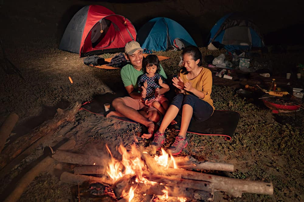 family camping at night