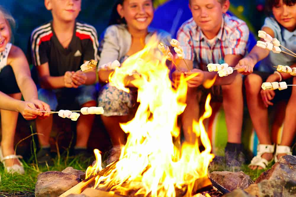 happy kids by campfire